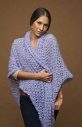 This simple triangle shawl is lacy and elegant. (Lion Brand Yarn)