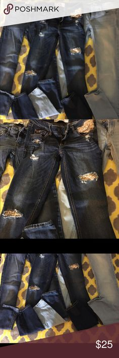 3 Pair Hollister Size 1 Jeans 1- Hollister Skinny Jeans Size 1R Medium color on left excellent condition 1- Hollister Skinny Jeans Size 1 Dark Distressed with Gold Sequins middle excellent condition 1- Hollister Skinny Jeans Size 1L Light colored left excellent condition.                                           Please ask any questions I have forgotten to provide. Thanks dolls. Hollister Jeans Skinny