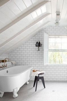 Love the look of subway tile, but not sure how to make it work in a small bathroom? Scroll on for eight novel ideas. #hunkerhome #subwaytile #subwaytileideas #smallbathroom #smallbathroomideas Modern Rustic Homes, Modern Rustic Decor, Rustic Home Design, White Bathroom Interior, Building A Cabin, Home Decor Store, Beautiful Bathrooms, Small Bathroom, Bathroom Ideas