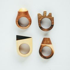 The rings are of the minimalist design, to be more precise, they represent the artist's flirting with geometric forms. Every piece is made from a specifically selected wood, or by the combination of two types of wood, in order to achieve the color contras…