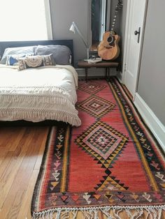 A hand-tied, wool, vintage Persian kilim with rich hues of yellow, red, blue, orange and brown. Vibrant, mid-century modern/bohemian hybrid look.