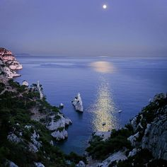 ✮ Night view over Calanque of Sugiton near Marseille, the moon reflected in water - France
