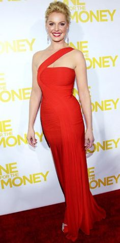 Look of the Day › January 25, 2012 WHAT SHE WORE Heigl walked the red carpet at the New York One for the Money premiere in an asymmetrical Herve L. Leroux gown, pave Sethi Couture shoulder dusters and crystal Jimmy Choo peep-toes
