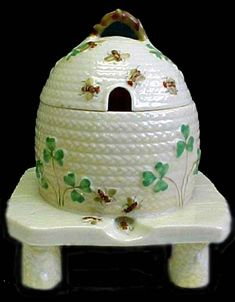 Belleek.  I have several pieces. Not this particular one, but its beautiful stuff!  :)
