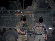 A British SFSG soldier (left), pictured with a U.S. Special Operations operator in Iraq. During their deployment to Iraq, in addition to wor...