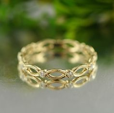 Infinity Love- 0.10 Carat Diamond Wedding Ring in 14K Yellow Gold Eternity Wedding Band Stacking Diamond Ring- Bridal Set Available.    Endless Infinity Love Continuous with Diamond Eternity Band.    *** This listing price is for ONE ring only!***    ***Matching Engagement Ring:   https://www.etsy.com/listing/225938452/infinity-love-14k-white-gold-conflict?ref=shop_home_active_2&ga_search_query=infinity%2Blove    ***Bridal Set…