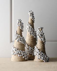 """Artisan"" Jingle Bell Cone Tree at Horchow. This would be and easy DIY - wrap styrofoam cones with twine and glue on jingle bells in a spiral"