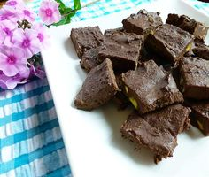 Healthy Chocolate Avocado Vegan Fudge    •1 -  3 oz. bar of bittersweet or dark chocolate – 70% or higher, chopped  •*1 ripe Large avocado, de-seeded and pureed  •*1/3 cup of organic full fat coconut milk (canned)  •*1/2 teaspoon vanilla extract  •*Stevia to taste  •*1/4 teaspoon salt  •*Raw pistachio nuts (chopped) or your choice of nuts – optional
