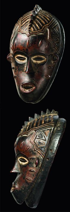 Africa   Female 'Djela' mask from the Guro people of the Ivory Coast   Iron wood; matt reddish brown patina, remains of black pain, kaolin and small traces of indigo blue pigment   ca. early 20th century