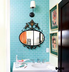find a cool mirror to hang above the sink instead of boring forgettable mirrors typically used in bathrooms.