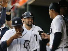 Detroit Tigers' Nick Castellanos getting congratulations