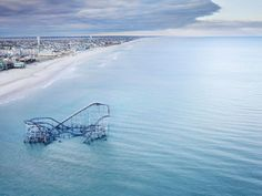 Stephen Wilkes for TIME  The Star Jet roller coaster at Casino Pier amusement park, once a Jersey Shore landmark, remains partly submerged in the Atlantic, Seaside Heights, N.J., 2012  Hurricane Sandy, One Year Later: Self-Portraits by Communities in Distress - LightBox