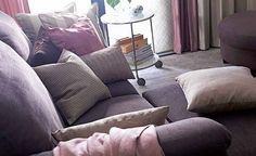 Using greys, dusky pinks and purples, layer your soft furnishings for a softer look.