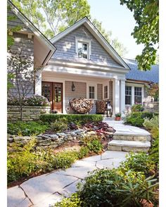 An absolutely beautiful home!!! And the yard is so happy!!! Love this! My favorite part is the wood on the front porch! by suitedesignco