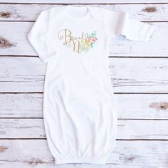 The perfect gown for your new precious baby girl. An incredibly soft fabric with the glitz and glam of glitter accents! Printed in sparkly gold glitter and watercolor glitter print. - Made of 65% Poly