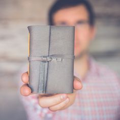 If you've got a special guy on your holiday shopping list, consider giving him a handbound journal with a rustic leather cover. These books are durable, portable, and the perfect spot for jotting down notes or planning his next big adventure. Leather Cover, Grey Leather, Yellow Paper, Cover Gray, Leather Books, Book Show, Handmade Books, Leather Journal, Guy
