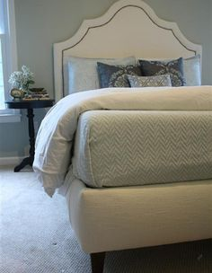 You can make your own upholstered bed. What's great about this upholstered bed is that the frame is made from affordable plywood, but who would know that when it's covered in fabric! For all you DIY Divas out there... upholstering a bed is just the same as upholstering an ottoman. http://www.home-dzine.co.za/bedroom/bedroom-upholster-bed.htm