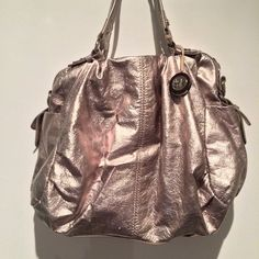 Metallic Gold The Sak Bag Love this but haven't used in awhile. Fun color. Medium size, room for everything you need. Good condition. Bags