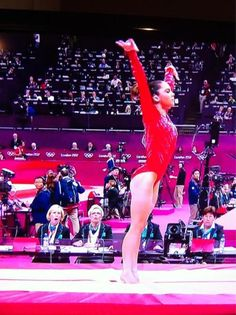 The now famous photo of the judges gaping at McKayla Maroney's beautiful stuck Amanar vault at the London 2012 Olympic Games!