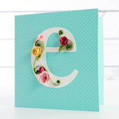 Lesson 5: Quilled Roses. Create a monogrammed card with roses using Cecelia's fast quilling technique. Learn to add details such as scored and bent leaves and rounded petals for a more realistic touch. You'll also learn how to arrange your blooms and work with different sizes to create a shadow box display anyone would love!