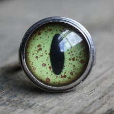Hey, I found this really awesome Etsy listing at https://www.etsy.com/listing/61158827/crocodile-eyeball-ring