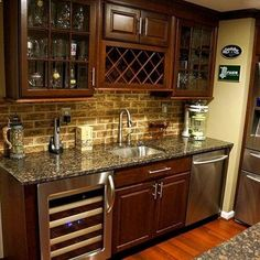 Bar in basement remodel? I would want this in my kitchen! Love the backsplash, granite countertops and appliances. The wine storage is a must somewhere in my retirement house.