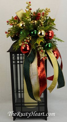 Christmas Lantern Swag, Christmas swag, mantel swag, Christmas decoration, Christmas lantern decoration, lantern topper, Holiday Swag, Holiday Lantern Swag, Christmas lantern, Lantern bow Our lantern swags are great way dress up any lantern! This swag is made with Christmas ribbon, berries, ornaments, and various greens. They are versatile and can be used on a wreath, mirror, and so many other places! The swag measures approx. 9 W x 16L. They simply attach with wired chenille. Lantern is…