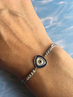 Evil Eye Bracelet Silver 925 Zircon Enamel, Waxed Cord, Protection Bracelet, Evil Eye Charm, Blue Evil eye, Greek Jewelry by ShinnyStella on Etsy Greek Jewelry, Evil Eye Charm, Sliding Knot, Evil Eye Bracelet, Adjustable Bracelet, Handmade Bracelets, Silver Bracelets, Cord, Wax