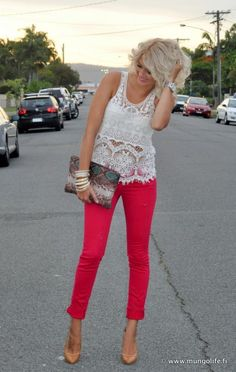 Lace top, red pants...