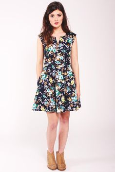 Louche Gael Flower Dress. Lightweight sleeveless dress. Navy blue with floral print. Fully lined. Exposed zip fastening to back. Removable leather look belt.