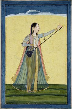 A woman tunes her tambura