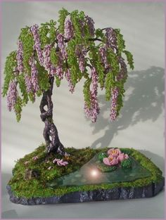 Pond side wisteria w/ lotus flowers. Glass used as water. Create the image that's in your mind! Here, a tranquil place to read, observe nature!