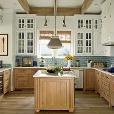 New Home Interior Design: The Ultimate Beach House - love the lower brown cabinets with the blue tile and white upper cabinets Two Tone Kitchen Cabinets, Upper Cabinets, Kitchen Redo, New Kitchen, Kitchen Remodel, White Cabinets, Maple Cabinets, Kitchen Island, Glass Cabinets