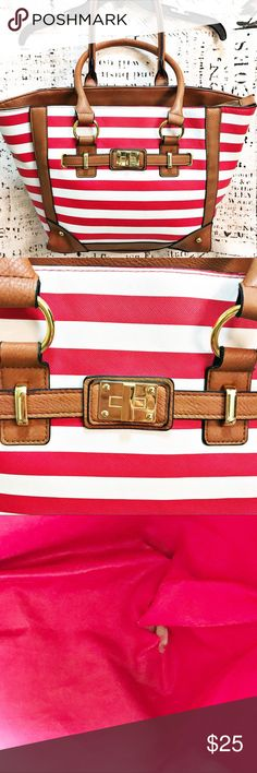 """Nautical Stripe Large Tote Purse Vinyl Bag Zip Top This nautical striped bag is so stylish and roomy! No brand label to be found, but who needs to name drop when your purse is so cute! Thick red and white stripes with gorgeous gold accents and brown edging and handles. 100% vinyl, so you essentially cannot possibly stain this bag. One tiny hole on the inside lining - see photo. Approx. measurements: 12"""" tall, 17.5"""" wide, 4.5""""x12"""" base. Perfect for every day or for a trip to the beach! Bags…"""