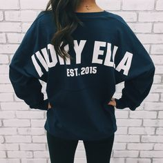 Our oversized Varsity Ella Jersey is the perfect top for a sporty everyday look.   6.5oz. 100% Cotton Jersey Knit Fabric Rounded Bottom Waist Oversized Cut, Tun