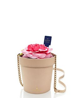 for our spring forward line, our designers embraced their inner eccentrics, creating a collection of whimsical handbags that celebrate the season; this witty flowerpot-shaped cross-body, for example, brings the delights of the garden to any ensemble.