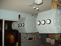 Millenium falcon loft bed with control panel and desk under.  Star Wars room.