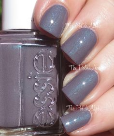Coat Couture is a blue toned purple with blue shimmer - shown with a shinny top coat over it - it's a matte on it's own