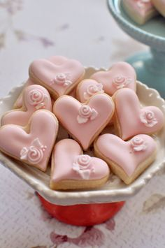 This listing is for 36 pieces of mini heart cookies with a single royal icing rosebud accent. Colors can be modified to your liking. The other