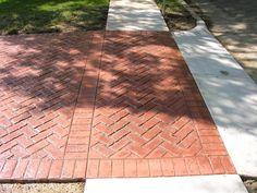 Stamped Driveway - but i like the design for brick, framed herringbone