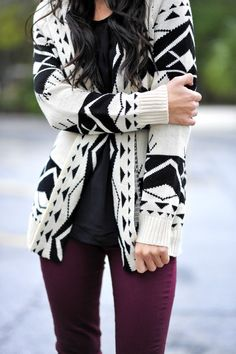 Wine colored pants and a black and white patterned sweater -- ideal for fall or winter