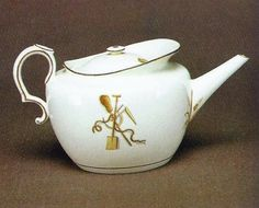 """Queen's ware """"Parapet"""" teapot, printed and painted with the """"Agricultural Implements"""" pattern, c1805."""