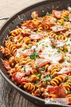 One Pot Pizza Pasta | This is guaranteed to become a family favorite.  Everyone loves pizza and this pasta is a mixture of marinara sauce and your favorite toppings including pepperoni and sausage.  Feel free to add your own spin on this dish.  Canadian bacon, olives and mushrooms would be other tasty toppings. @chewoutloud