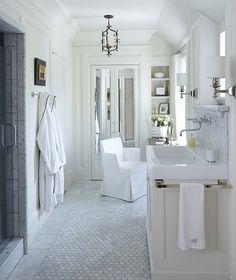 Bathroom. Marble Flooring Bathroom. Stunning bathroom with marble tiled walk-in shower with glass door opposite an ivory sink vanity. #Bathroom #MarbleBathroomFlooring Dungan Nequette Architects.
