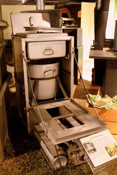 This artifact is a Model 1937 Field Range, a style first developed at the Quartermaster Depot in Jeffersonville, Indiana. These ranges first saw heavy use in World War II, and have continued in service to the present day. It was created to provide an array of cooking capabilities in the field, with the ability to serve up to fifty soldiers from one unit. It consists of an aluminum and steel cabinet, which serves as a cooking chamber, and a separate fire unit. — at U.S. Army Quartermaster…