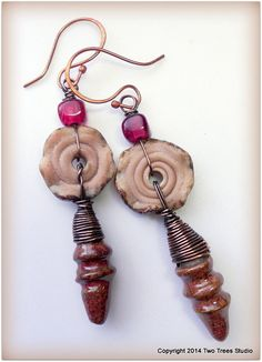 Ruffly lampwork glass disks of a delicate pink-beige are paired with beautiful little pink-red clay drops and vibrant fuchsia lampwork cubes. The result: Pretty with a touch of rustic. By Two Trees Studio, $34.00.