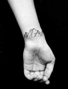   gorgeous mountain tattoo on arm