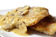 Pork chops with mushroom gravy - no cream of mushroom soup in this one. Personally I am not a fan of pork chops, but would love to substitute chicken. Yum!