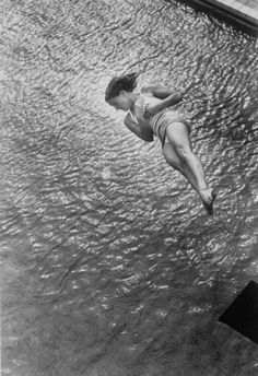 "hauntedbystorytelling: "" Ralph CRANE :: Pat McCormick diving at the 1952 Olympic Games in Helsinki, Finland more [+] by this photographer "" Diving Springboard, Between Two Worlds, Life Aquatic, White Image, Olympic Games, Olympic Team, Helsinki, Vintage Photography, Black And White Photography"