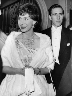 HRH Princess Margaret wearing a pair of diamond earrings she frequently wore, a diamond floral brooch, three diamond bracelets, and a necklace made with parts of the Poltimore tiara.